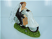 Wedding cake topper on a bicycle meant for two